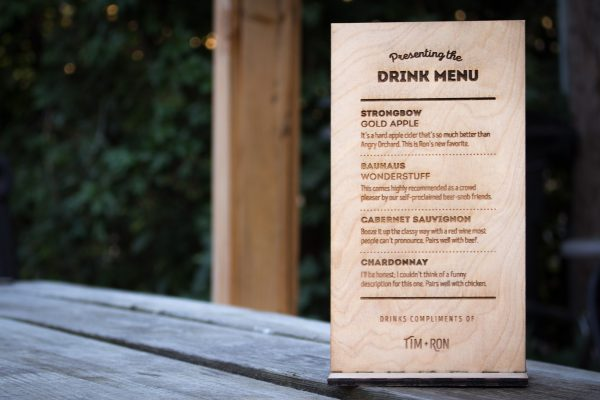Laser etched wooden drink menu for the open bar at a wedding reception.