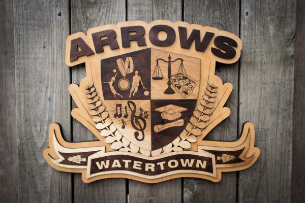 Expanded, full-width view of wooden Watertown Arrows Emblem